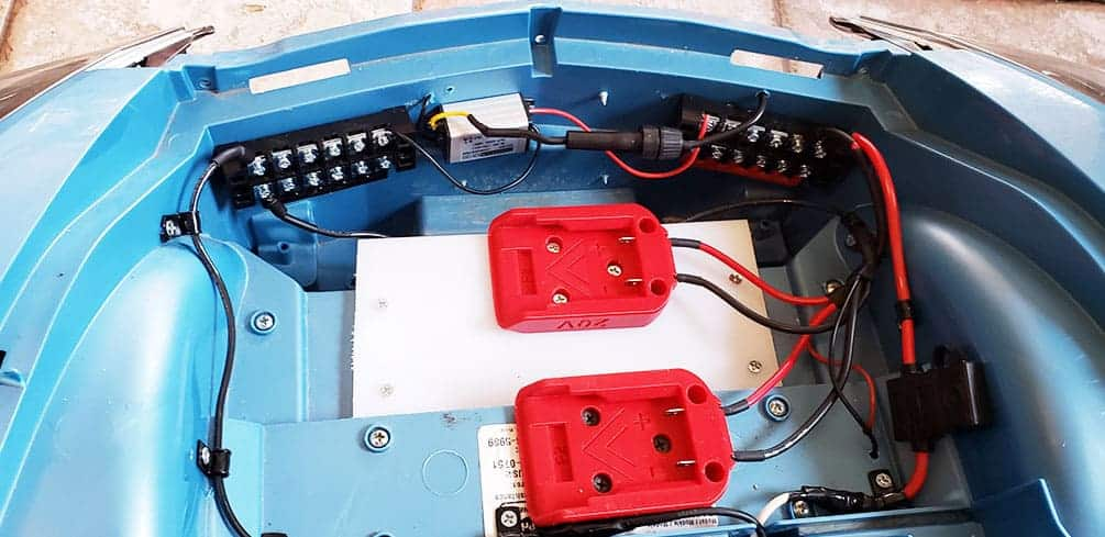 Power Wheels with distribution blocks and two 20V batteries.